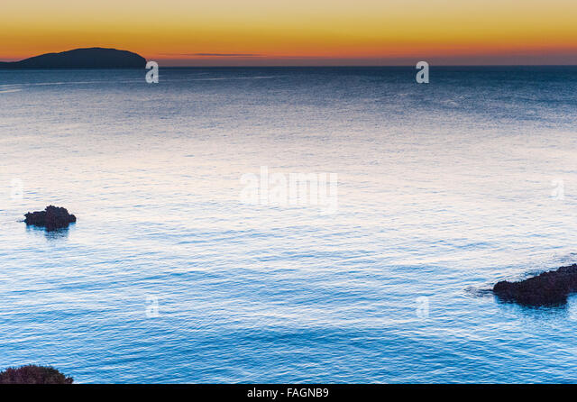 Sunrise over the calm beautiful water in Es Canar, Ibiza, part of the Balearic Islands in Spain,Europe. - Stock Image