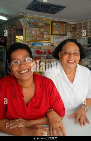 Curaçao Netherlands Antilles Dutch Willemstad Punda Breedestraat food vendor family business Black woman adult - Stock Image