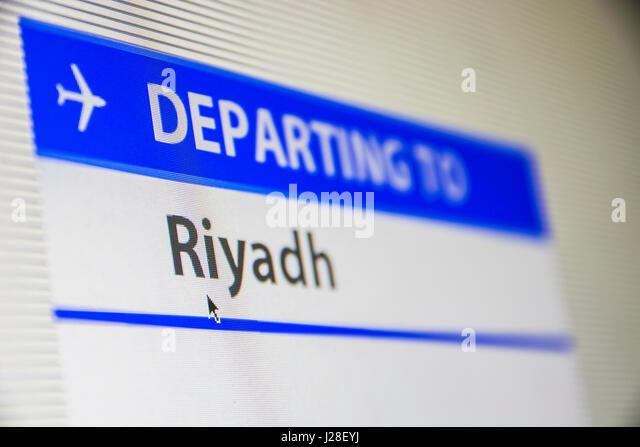 Computer screen close-up of status of flight departing to Riyadh, Saudi Arabia - Stock Image