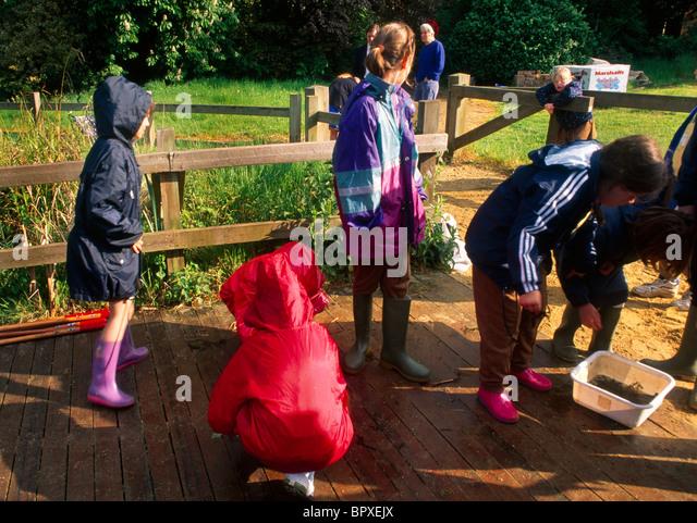 Children wearing wellingtons stock photos children for Garden pond waders