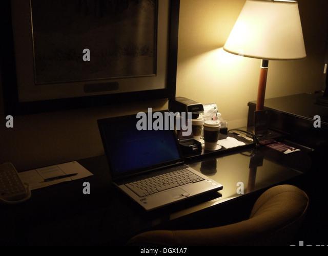 business travel hotel room laptop working late - Stock-Bilder