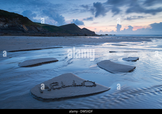 A welcome message left in the sand on Crackington Haven Beach, Cornwall, England. Summer (August) 2013. - Stock Image