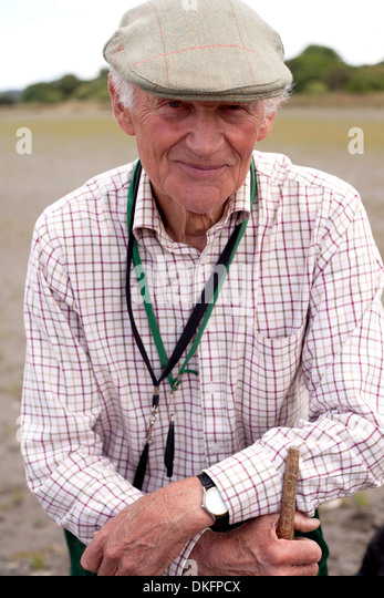 Portrait of senior man wearing flat cap - Stock Image