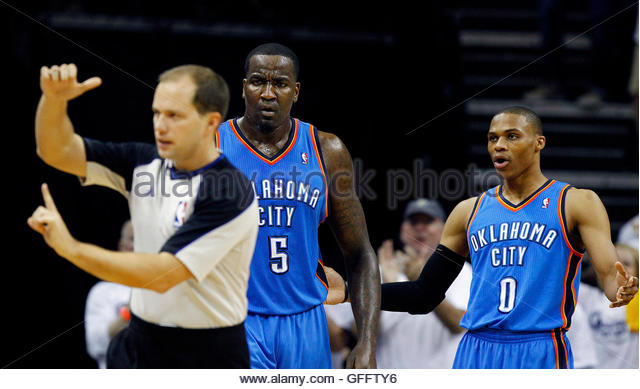 Official John Goble (L) hits Oklahoma City Thunder Kendrick Perkins (C) with a technical foul as teammate Russell - Stock Image
