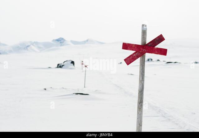 Sign on pole in winter - Stock-Bilder