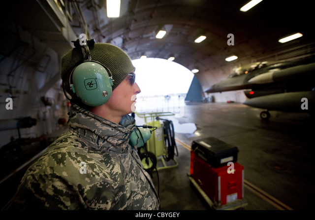 Staff Sgt. Benjamin Casarez stands by to help power down a returning jet March 6 at Misawa Air Base, Japan. Sergeant - Stock Image