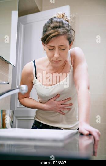 WOMAN FEELING NAUSEOUS - Stock Image