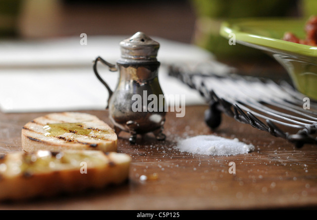 Roasted baguette slices with honey - Stock Image