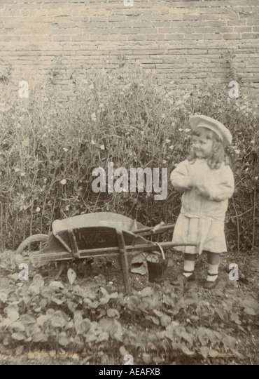 Cabinet photograph of child in garden  circa 1890 - Stock Image