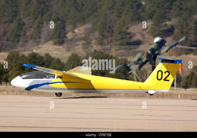 A TG-10B glider lifts into the air as it is towed down the runway. - Stock Image