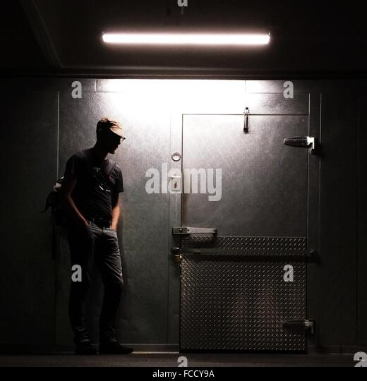Man Looking At Locked Door - Stock Image