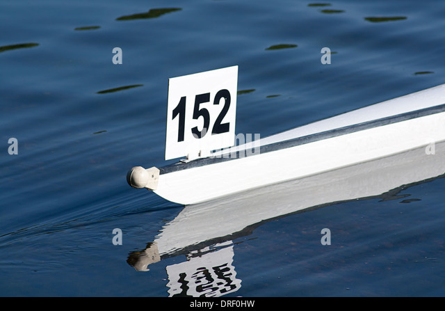 Racing boat shell competing in a competitive rowing race - Stock Image