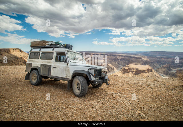 Namibia, Africa - Land Rover parked next to the Fish River Canyon - Stock Image
