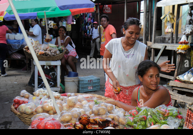 Nicaragua Granada Calle Atravesada shopping market produce vendor Hispanic woman informal economy vegetables agriculture - Stock Image