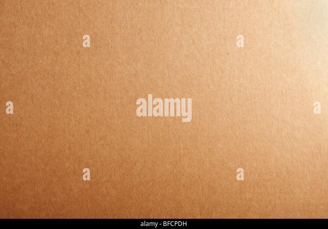 Blank beige cardboard textured background. - Stock Image