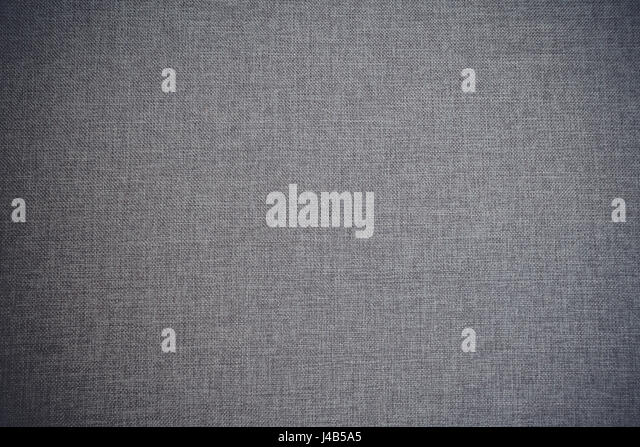 Textile background in grey color in wool fabric with classic fiber texture - Stock Image