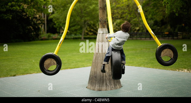 Six year old boy plays in the park - Stock-Bilder
