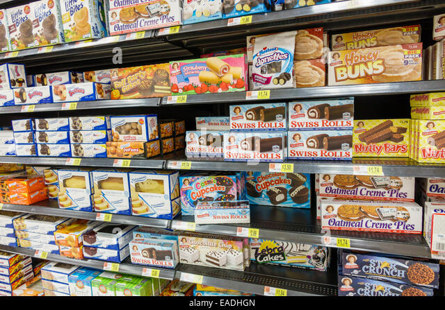 Miami Florida Walmart sale shelves junk food desserts sweets cakes Little Debbie Entemann's - Stock Image