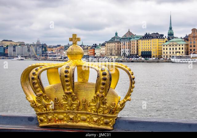 Golden crown on Skeppsholmsbron bridge. Stockholm, Sweden, Scandinavia - Stock Image