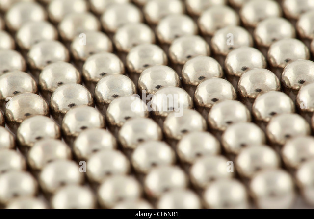Silvery beads are interlaced together - Stock Image