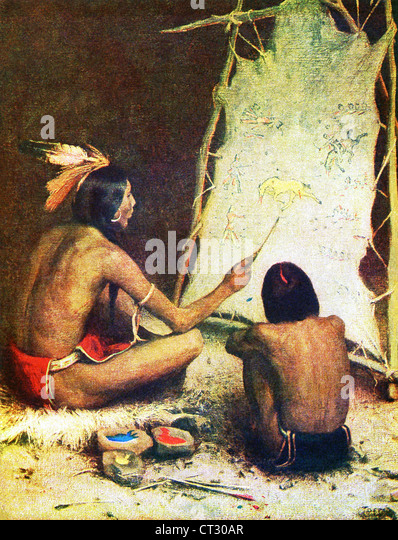A Native American artist is painting in sign language, on buckskin, the story of a battle with American soldiers. - Stock-Bilder