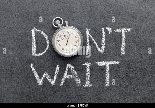 don't wait phrase handwritten on chalkboard with vintage precise stopwatch used instead of O - Stock Image