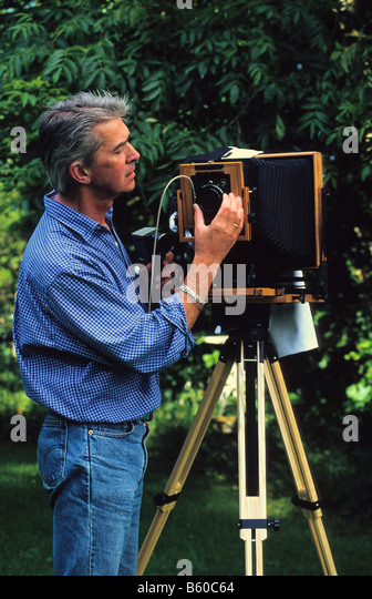 Photographer (self-portrait) with Lotus View 5x7 large format folding camera. - Stock Image
