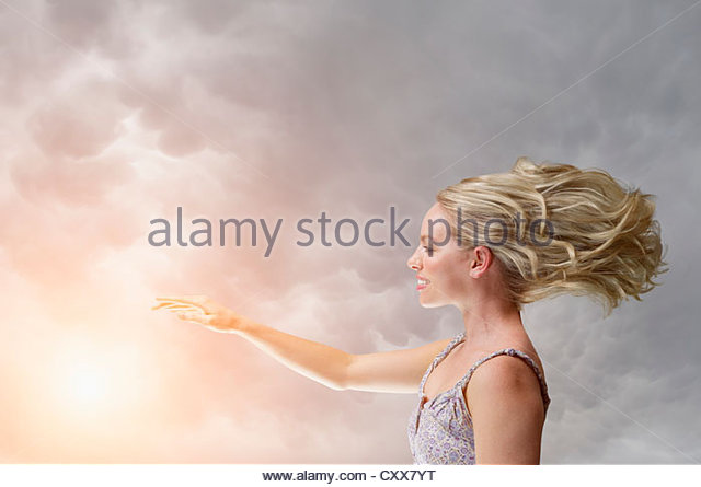 Caucasian woman with arm outstretched - Stock Image