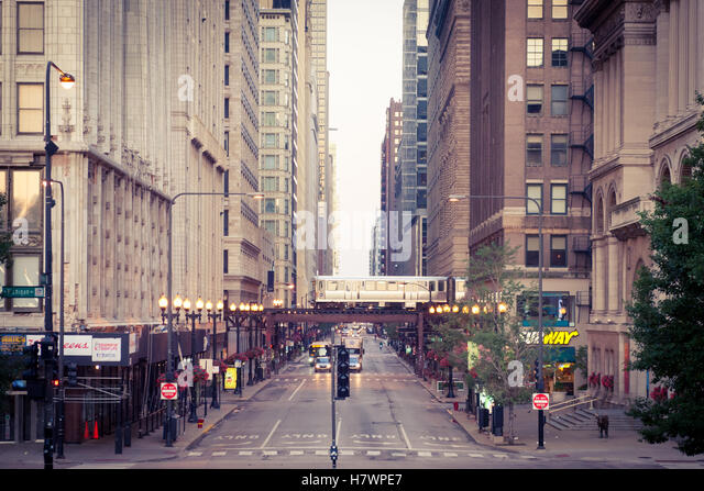 Looking west down East Washington Street in Chicago.  The elevated train (L Train) is in the distance. - Stock Image