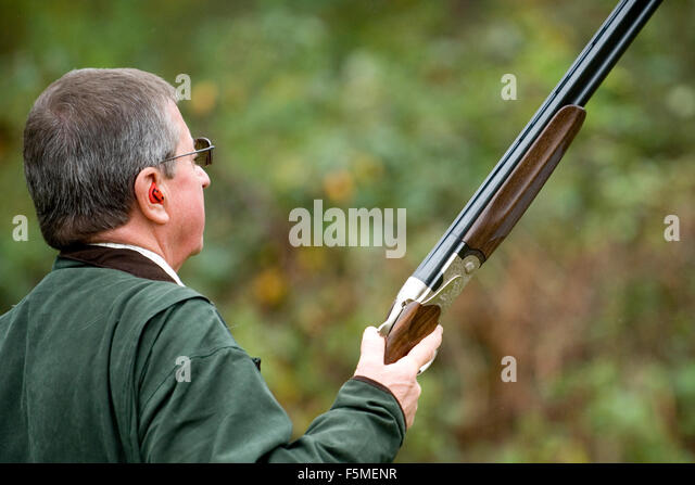 Man out shooting - Stock Image
