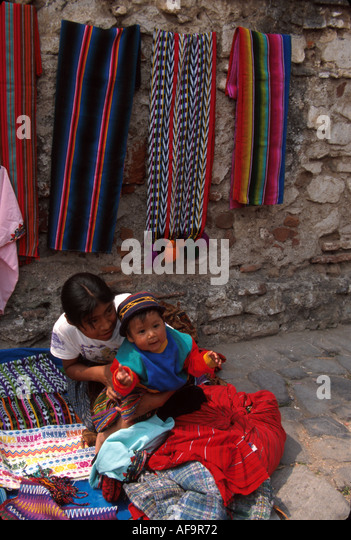 Guatemala La Antigua colonial capitol until earthquake Cakchiquel Indigenous family vendors - Stock Image