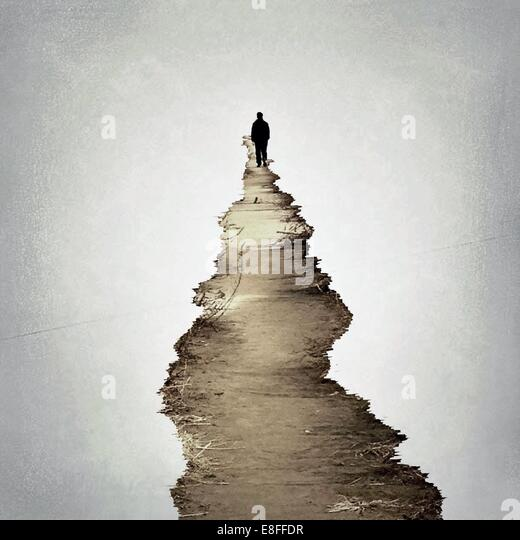 South Korea, Seoul, lonely man standing at the end of footpath - Stock Image