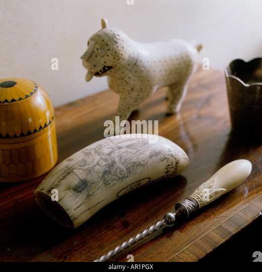 ivory and wood objects on top of a chest in an English country house - Stock Image