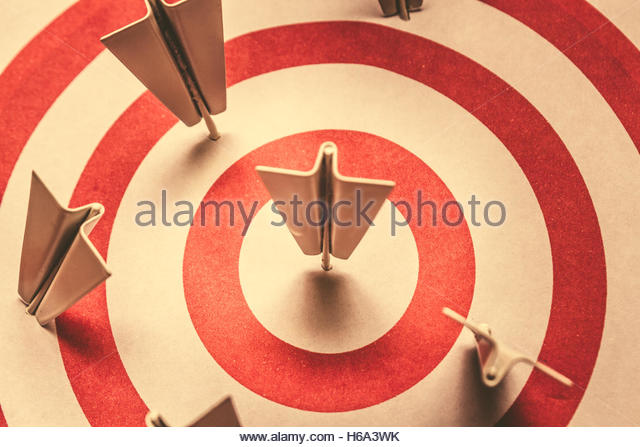 Vintage style business metaphor on plane pushpins hitting goals with centre success. Marketing your target market - Stock Image