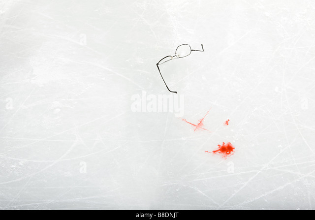 Eyeglasses and blood on the ice - Stock Image
