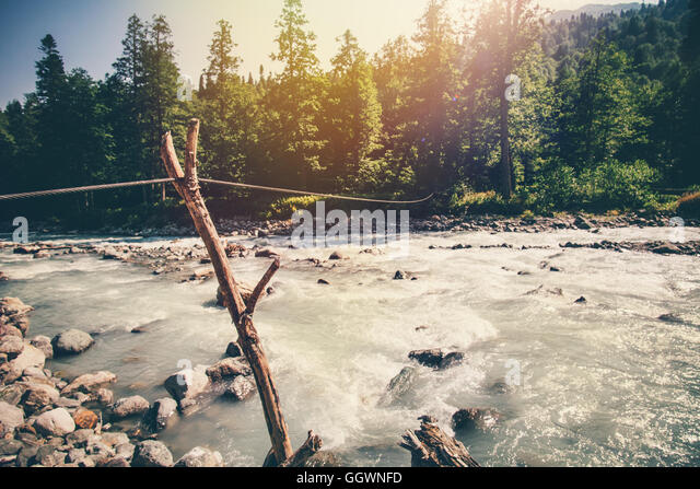 Mountains River and forest Landscape with cable rope to crossing scenic view wild nature summer travel in Abkhazia - Stock Image