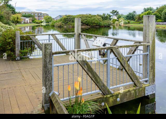Wooden viewing platform over the lake at Mewsbrook Park, Littlehampton, West Sussex, England. - Stock Image