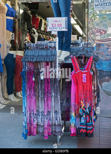 Very inexpensive summer dresses for sale at Lola's on Junction Boulevard in Corona Queens, New York. 6/24/2016. - Stock Image