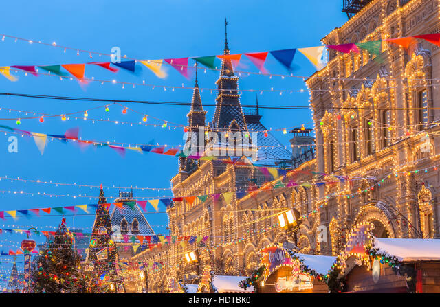 Dusk view of the Christmas market at the Red Square in Moscow, Russia - Stock Image