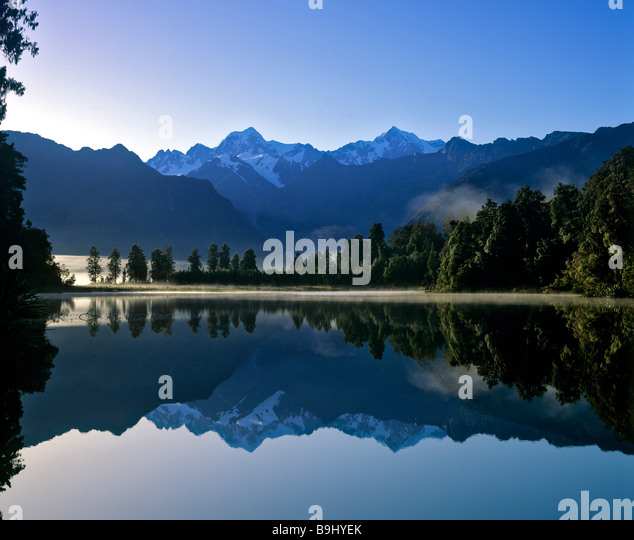 Matheson Lake with Aoraki or Mount Cook reflected on surface, Southern Alps, South Island, New Zealand - Stock-Bilder
