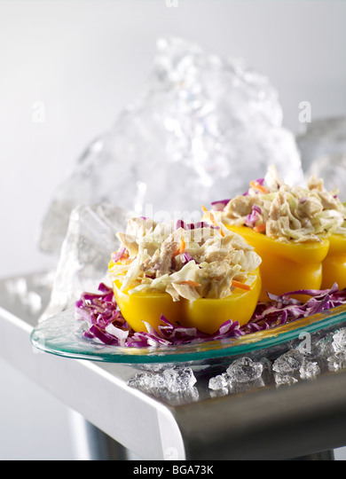 Tuna salad stuffed yellow peppers - Stock Image