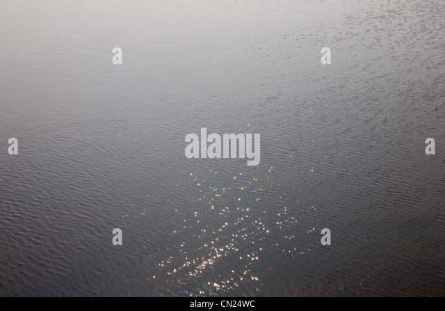 Sunlight reflected on lake - Stock Image