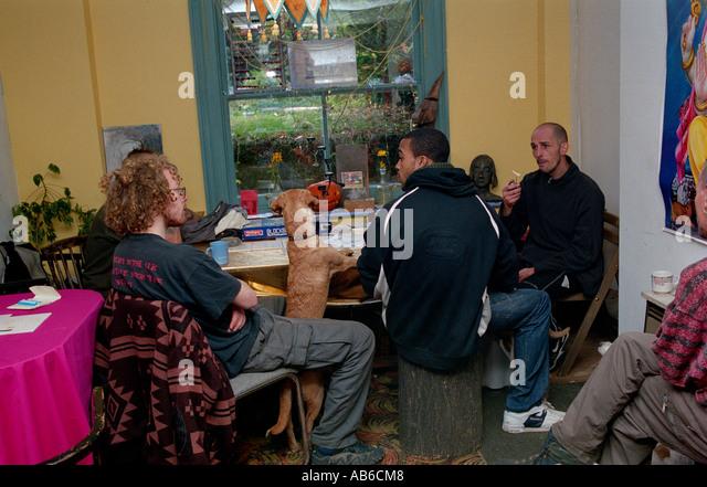 People socialising Cafe at St Agnes Place Squat Kennington South London. - Stock Image