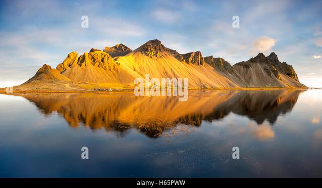 Panoramic view of the reflected Vestrahorn mountain, Hofn Stokksnes Peninsula Iceland. - Stock Image