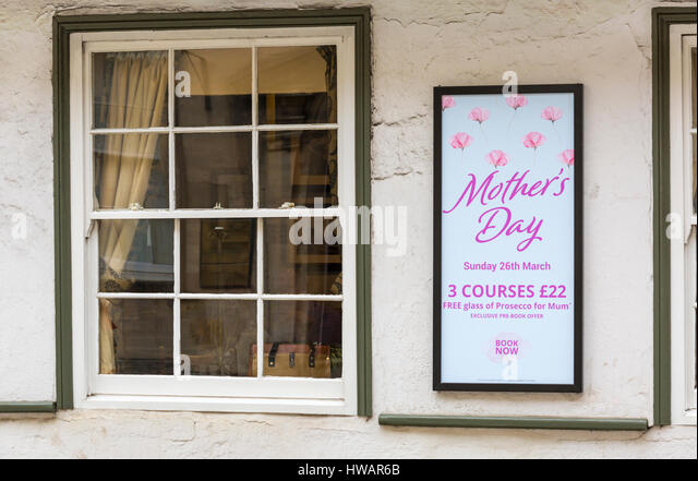Mothers Day meal on Sunday 26th March including free glass of Prosecco for mum - sign on wall of The Bear Inn at - Stock Image