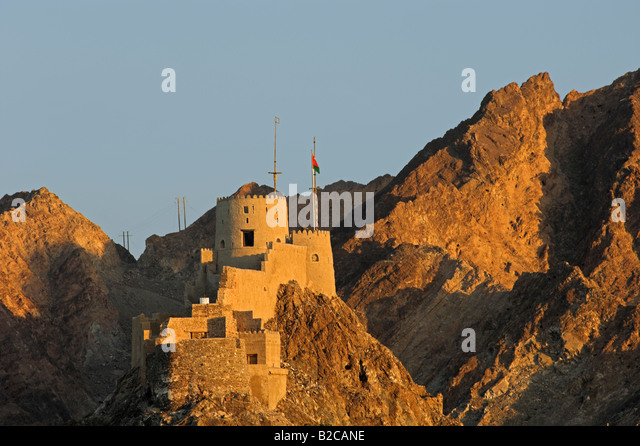 Historic Mutrah Fort in hills the old town of Muscat Oman - Stock Image