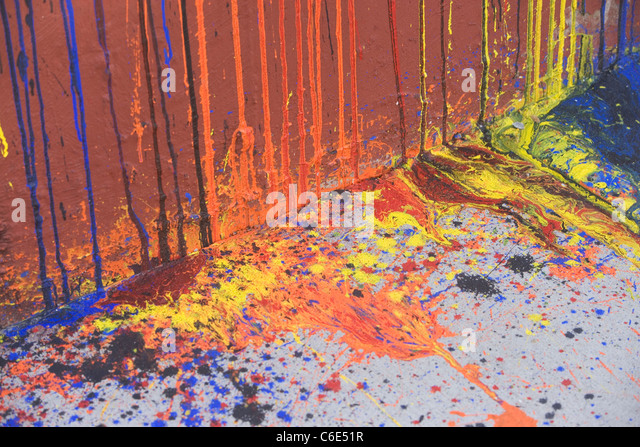 USA, New York State, New York City, dripping paint on wall and asphalt - Stock Image
