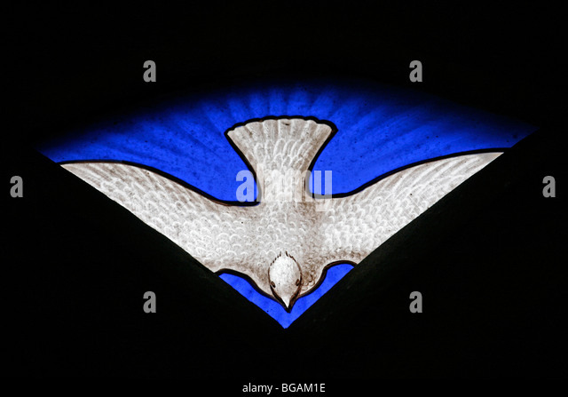 A stained glass window depicting the dove of the Holy Spirit, St Nicholas Church, Fisherton Delamare, Wiltshire - Stock Image