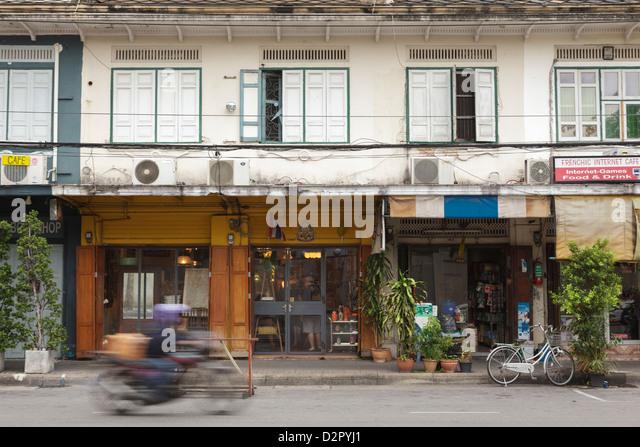 A motorbike rides past a shop front in Rattanakosin, Bangkok, Thailand, Southeast Asia, Asia - Stock-Bilder