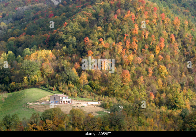 A house standing in the wonderful Autumn or fall colors in the Sibillini National Park of Le Marche ,Italy - Stock Image